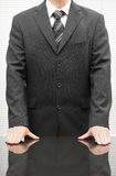 Closeup  of a well dressed businessman with hands on the desk Royalty Free Stock Photography