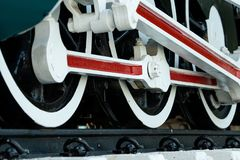 Closeup wheel of train. Green red and white train. Antique vintage train locomotive. Old steam engine locomotive. Black locomotive royalty free stock photos