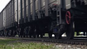 Freight train wheels passing by