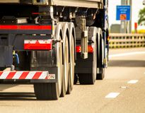 Wheels In Motion. A closeup of wheels in motion from an articulated lorry, traveling along a UK motorway royalty free stock photos