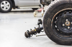 Closeup wheels and shock absorbers. With repair the suspension on the car. soft-focus and over light royalty free stock images