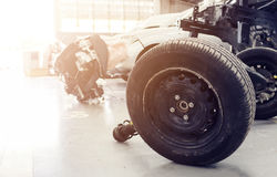 Closeup wheels and shock absorbers. With repair the suspension on the car. soft-focus and over light stock photography