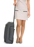 Closeup on wheels suitcase near legs woman Stock Images