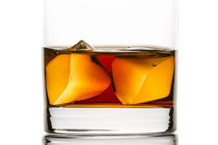 Closeup whisky with ice cubes Stock Images