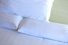 Closeup of white bedclothes and pillow Stock Image