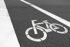 Closeup white bicycle symbol is on car road Stock Photo
