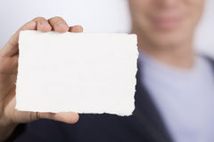Closeup of white blank card. Royalty Free Stock Image