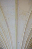 Closeup white ceiling supported by old columns. Architectural part Royalty Free Stock Photos
