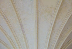 Closeup white ceiling supported by old columns. Architectural part Stock Photography