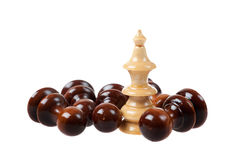 Closeup of White Chess Queen. Standing in Front of Falling White Pawns Royalty Free Stock Images