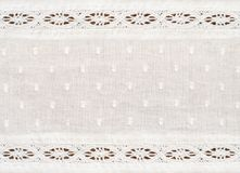 Closeup of white cotton fabric with lace borders. For background. Top view Stock Photos