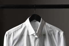 Closeup of a white dress shirt on a black hanger Stock Photo