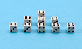 White gamble dice pyramid blue background Royalty Free Stock Photos