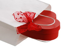 Closeup of white gift bag with red bow and heart Royalty Free Stock Image