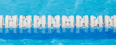Closeup of white lane rope in swimming pool for competitions. Stock Photography