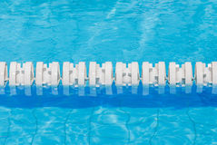 Closeup the white marked lanes in swimming pool for competitions Royalty Free Stock Photo