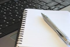 Closeup   white note and pen Royalty Free Stock Photo