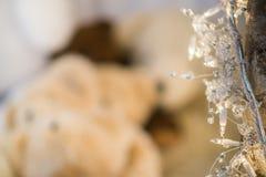 Closeup white ornament and christmas lights wrap around birch branch stock photos