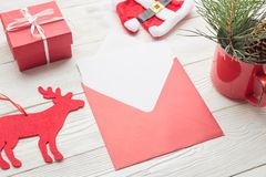 Close-up of white paper card with Christmas envelope stock images