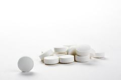Closeup with white pills, isolated Stock Photos
