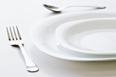 Closeup of white place setting Stock Photos