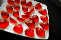 Homemade strawberry jelly or jellies on white plate Royalty Free Stock Images