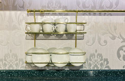 Closeup of white plates in a cupboard. Royalty Free Stock Image