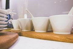Closeup of white plates and dinnerware. Display on shelf with light flare effect stock image