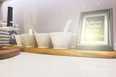 Closeup of white plates and dinnerware display on shelf with lig Royalty Free Stock Images