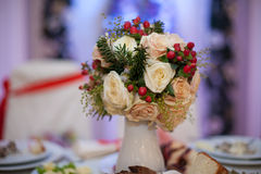 Closeup of white roses wedding bouquet at reception.  Royalty Free Stock Image
