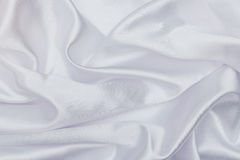 Closeup of white satin fabric Royalty Free Stock Photos