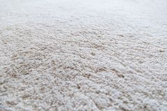 Closeup of a white shaggy carpet royalty free stock photography