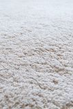 Closeup of a white shaggy carpet royalty free stock image