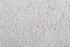 Closeup of white shaggy carpet texture royalty free stock photo