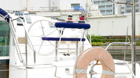 Closeup white sightseeing vessel with lifebuoy Royalty Free Stock Image