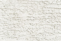 Closeup of White Stucco. Closeup of the texture of stucco painted white Royalty Free Stock Images