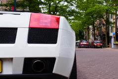 Closeup of a white super car parked in the street royalty free stock photos