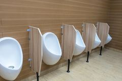 White urinals in men`s bathroom Royalty Free Stock Photography