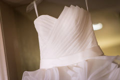Closeup of white wedding gown Royalty Free Stock Photos