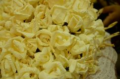 Closeup white and yellow Sandalwood flowers for a funeral ceremo. Closeup white and yellow Sandalwood flowers for a funeral Thailand local ceremony royalty free stock image