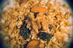 Closeup white youghurt with granola, almonds and Stock Photo