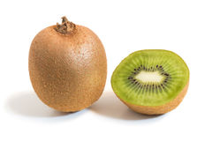 Closeup of a whole and half kiwifruits with shadow Stock Images