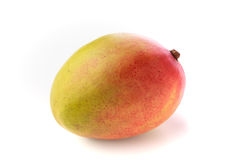 Closeup of whole isolated mango. Closeup of whole isolated spotted red and yellow mango on a white background Stock Image