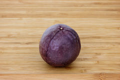 Closeup of a whole passion fruit Royalty Free Stock Photos