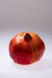 Closeup of whole pomegranate Stock Photo