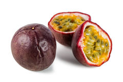 Closeup of a whole and split passion fruits Royalty Free Stock Image