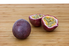 Closeup of a whole and split passion fruits Stock Images