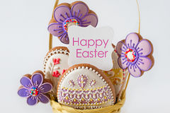 Closeup of wicker basket with tasty Easter cookies royalty free stock image