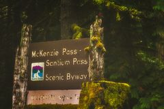 Closeup of McKenzie Pass-Santiam Pass Scenic Byway Sign. Closeup of Willamette National Forest sign of the McKenzie Pass-Santiam Pass Scenic Byway in Oregon`s royalty free stock photography