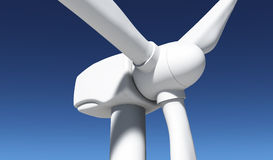 Closeup of a wind generator. A closeup of a front of a white rotor of a wind generator with a clear blue sky on the background Royalty Free Stock Photos